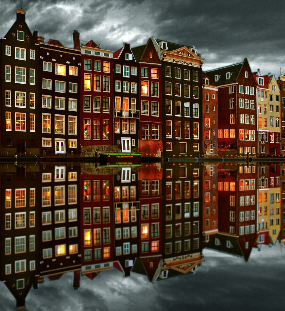 Amsterdam homes canal water reflection